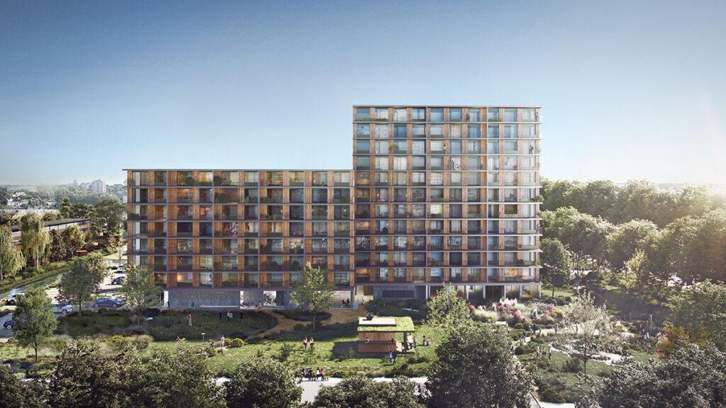 Balkone, Gemeinschaftsgärten und viel Grün rundum: Der neue Holzwohnbau in Rotterdam. (Bild: Powerhouse Company)